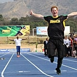 Harry took his infamous sprint to the finish line against Olympic gold medalist Usain Bolt during a visit to Jamaica in March 2012.