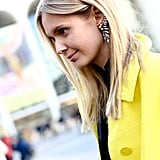 Statement earrings took center stage with tucked-back hair and a natural-looking makeup palette.