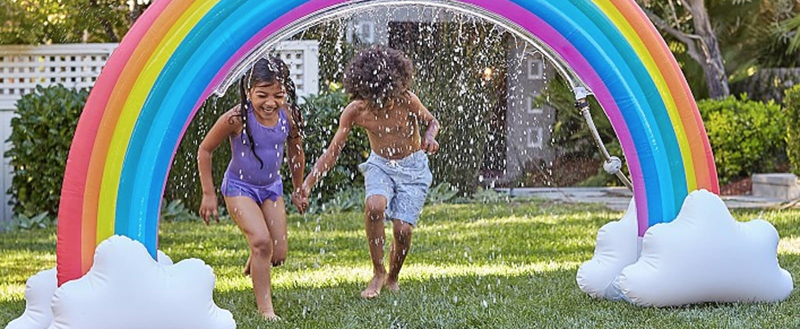 Add This Magical, Inflatable Rainbow Sprinkler to the List of Toys You NEED This Summer