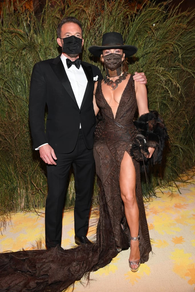 Somewhere on Manhattan's Upper East Side, Jennifer Lopez and Ben Affleck shared a steamy kiss that would rival any cowboy romance — and they didn't even bother to peel off their masks first. While attending the 2021 Met Gala on Monday, J Lo wore a feathered Ralph Lauren dress and a matching face mask. Possibly seduced by her sleek cowboy hat, Ben couldn't help but pull Jennifer in for a masked kiss in front of the cameras.  Ben and Jennifer made their first red carpet appearance as a couple since rekindling their romance in May at the Venice International Film Festival on Sept. 9. But it was in between flashing photographer snaps and checking to make sure their angles were spot-on that the couple truly made an impression with their passionate display of affection. See Jennifer and Ben sharing sweet cuddles and obstacle-defying kisses at the Met Gala here.      Related:                                                                                                           Every Look From the 2021 Met Gala Red Carpet That We Can't Stop Talking About (So Far)