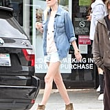 Kate Bosworth added a chambray button-down to her faded denim cutoffs for that cool-girl denim-on-denim effect.