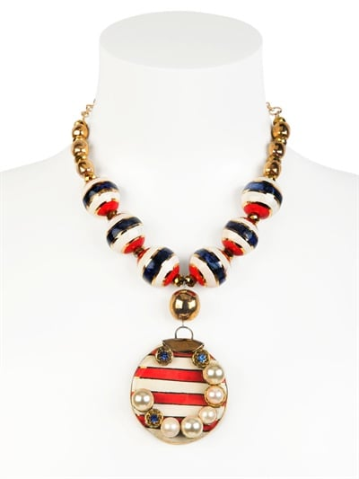 Dress up your most laid-back outfit (cutoffs and a white tee, anyone?) with this luxe, gold-plated necklace ($1,077).