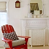 Cordon off the fireplace altogether with a matching-colored furniture piece, such as this white wicker panel.  Source