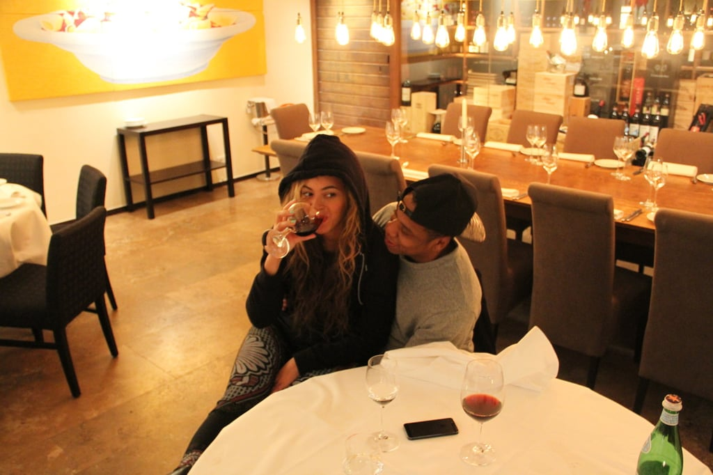 Beyoncé Knowles posted photos from her recent trip to Berlin on her Tumblr account. She and Jay-Z were there last week for the latest stops on her Mrs. Carter Show world tour, though they had plenty of time away from the stage. Beyoncé and Jay-Z snapped pictures in front of a graffitied wall and cozied up at dinner, and one shot even shows Beyoncé drinking a glass of wine at a restaurant. We can't help but wonder — is she trying to put recent pregnancy rumors to rest with the image after speculation started earlier this month? Let us know what you think in the comments! Source: Tumblr user Beyoncé
