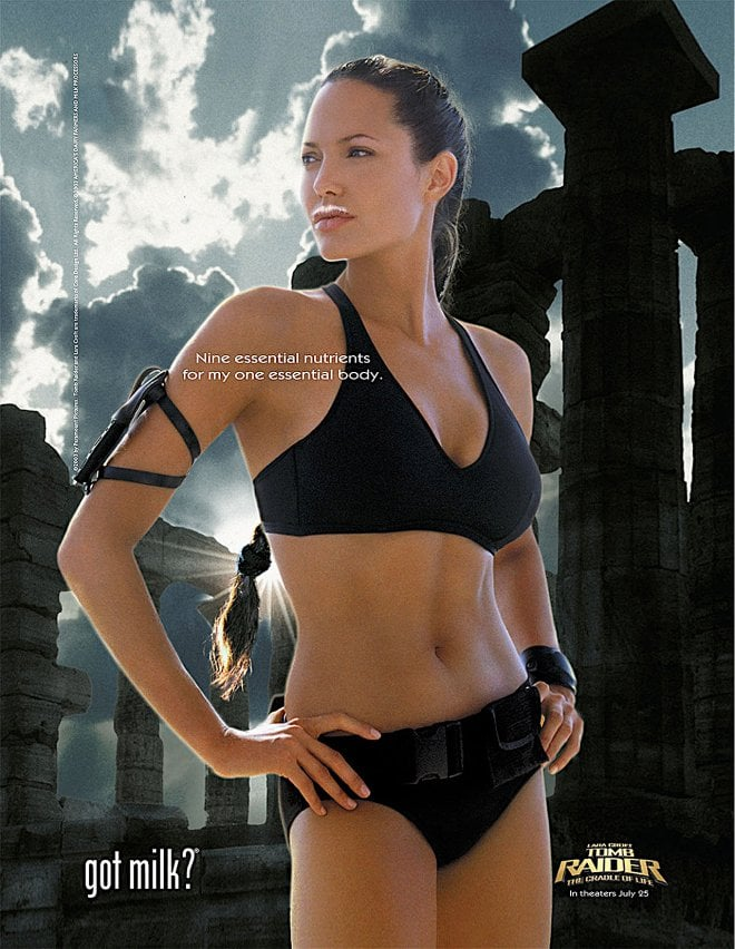 Angelina Jolie channeled Lara Croft, rocking a black bikini with her milk mustache.