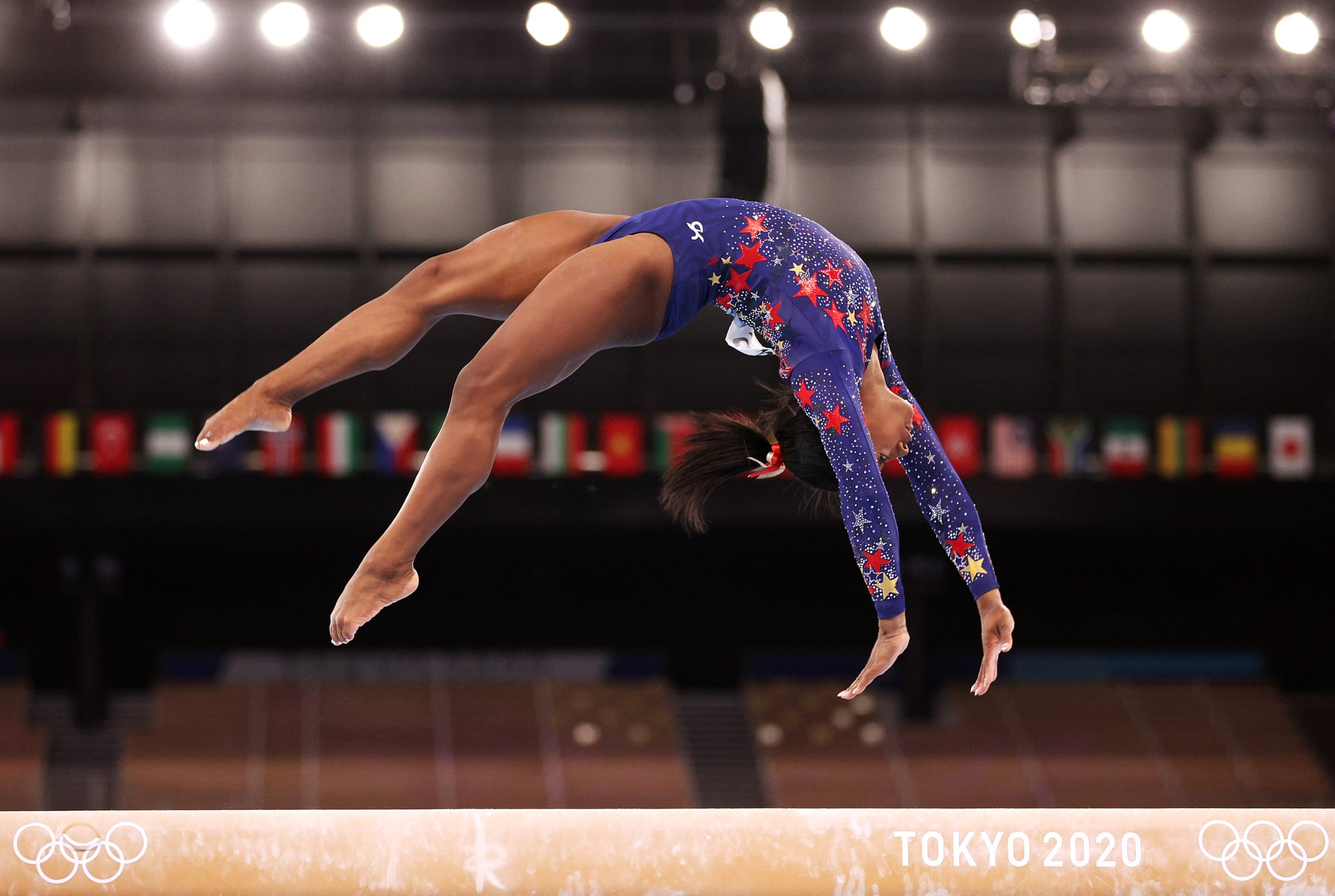 TOKYO, JAPAN - JULY 25: Simone Biles of Team United States competes on balance beam during Women's Qualification on day two of the Tokyo 2020 Olympic Games at Ariake Gymnastics Centre on July 25, 2021 in Tokyo, Japan. (Photo by Ezra Shaw/Getty Images)