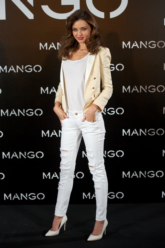 """Miranda Kerr was up this morning to celebrate her new deal with Mango in Spain, where the company is based. She donned clothes from the brand for a photocall at the Villa Magna Hotel in Madrid. Miranda was announced as the face of Mango's Spring 2013 campaign last month, but her duties with Victoria's Secret kept her more than busy in the interim. Miranda's also in the running to clinch the title of our top model of 2012 —who gets your vote? Once her work with Mango is done, Miranda can look forward to a holiday with her boys, Orlando and Flynn Bloom. She told us two weeks ago that she has a long-planned end-of-year reunion coming with her husband. Miranda said, """"Orlando is still filming in South Africa, but I am going to see him really soon when he finishes up."""""""