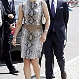 Crown Princess Victoria of Sweden wearing a snakeskin outfit.
