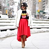 Girly With a Full Skirt and Jacket Over the Shoulders