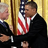 President Obama and former President Bill Clinton shook hands after Obama presented him with a Medal of Honor.