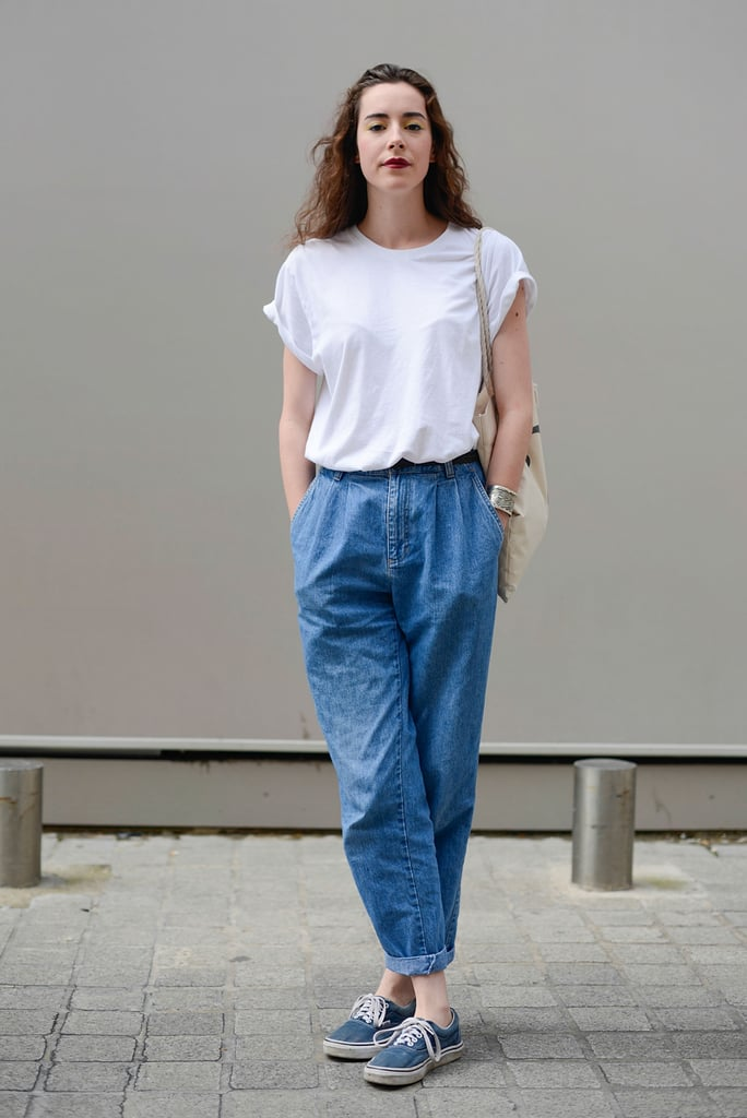 With a White Tee Tucked Into Baggy Denim Pants
