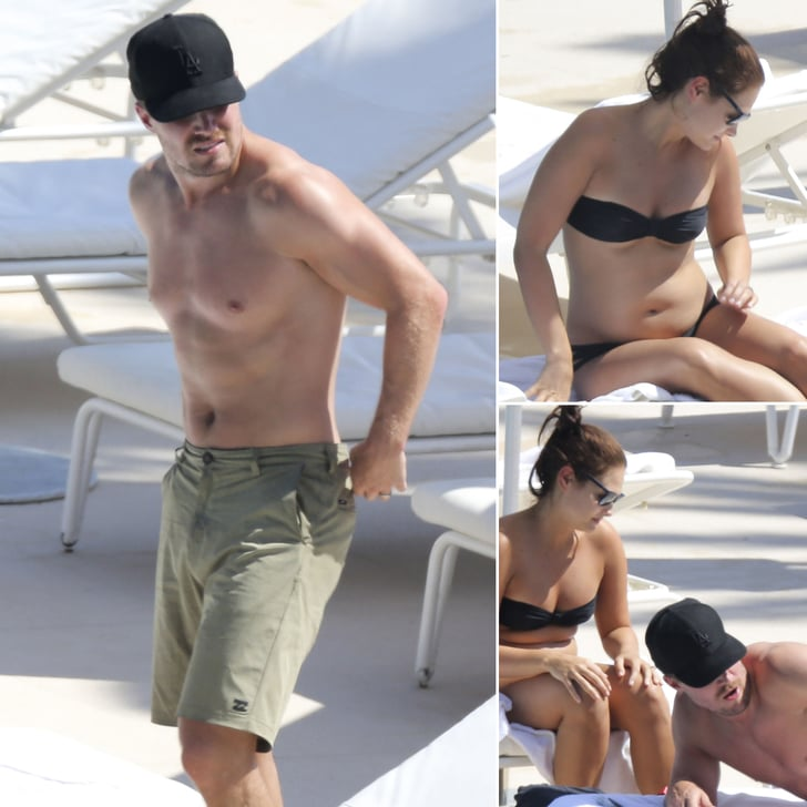 Arrow Star Stephen Amell and His Pregnant Wife Lounge Poolside