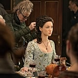 Balfe gets her intricate updo styled in between takes during a season four scene that sees Claire eating dinner with some of her new American acquaintances.