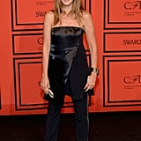 Nina Garcia proved the power of simple dressing in a strapless top, which she paired over loose-fitting tuxedo pants.