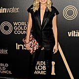 Malin Akerman, seen at the 2013 Golden Globe Awards season party, worked a sexier take on the menswear-inspired trend in a short-sleeved blazer with a plunging neckline, slim black pants, and pumps. We also love the shot of print on her clutch.