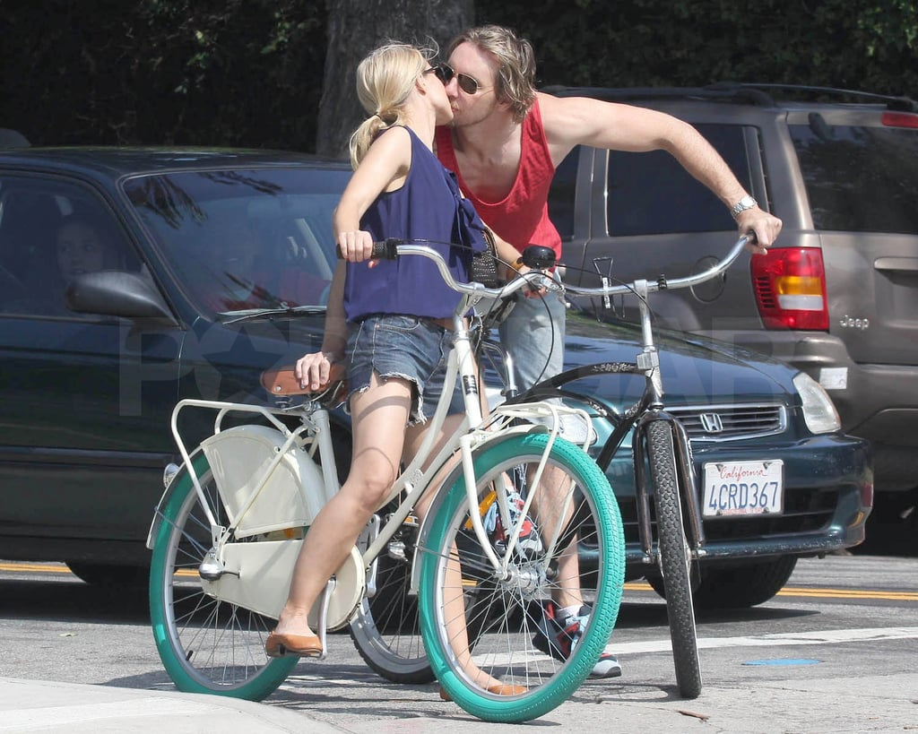 Kristen Bell and Dax Shepard hopped on the back of two beach cruisers and took to the streets of LA on Saturday. The pair rode around town and stopped for an occasional kiss. Kristen's back from a recent trip to South Africa, where she swam with sharks, and is gearing up for the Jan. 8 premiere of her new Showtime series, House of Lies. Her schedule is jam-packed with projects in the new year; in addition to narrating Gossip Girl Kristen's also starring with Drew Barrymore and John Krasinski in the whale tale, Big Miracle. Dax's acting career is right on track as well with a new storyline stirring up drama for his Parenthood character. Kristen and Dax have been engaged for almost two years and are clearly going strong, despite not sharing any wedding plans just yet.