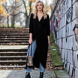 Layer your dark wrap dress over jeans and complete with heeled booties.