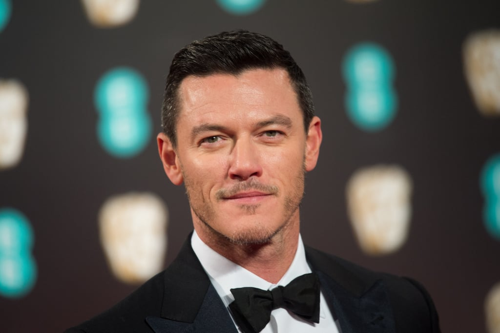 If you haven't heard of Luke Evans yet, allow us to introduce your next celebrity crush. Not only did the 37-year-old Welsh actor star in the book-to-movie adaptation of The Girl on the Train, but he's also making hearts swoon as Gaston in Disney's live-action Beauty and the Beast. And if you think you recognize him, that's because he's made past appearances in movies like Fast & Furious 6 and Dracula Untold. If his piercing eyes don't grab your attention, then his incredible singing voice definitely will. Keep scrolling for some of his hottest pictures over the years, and get ready to start hard-core crushing.