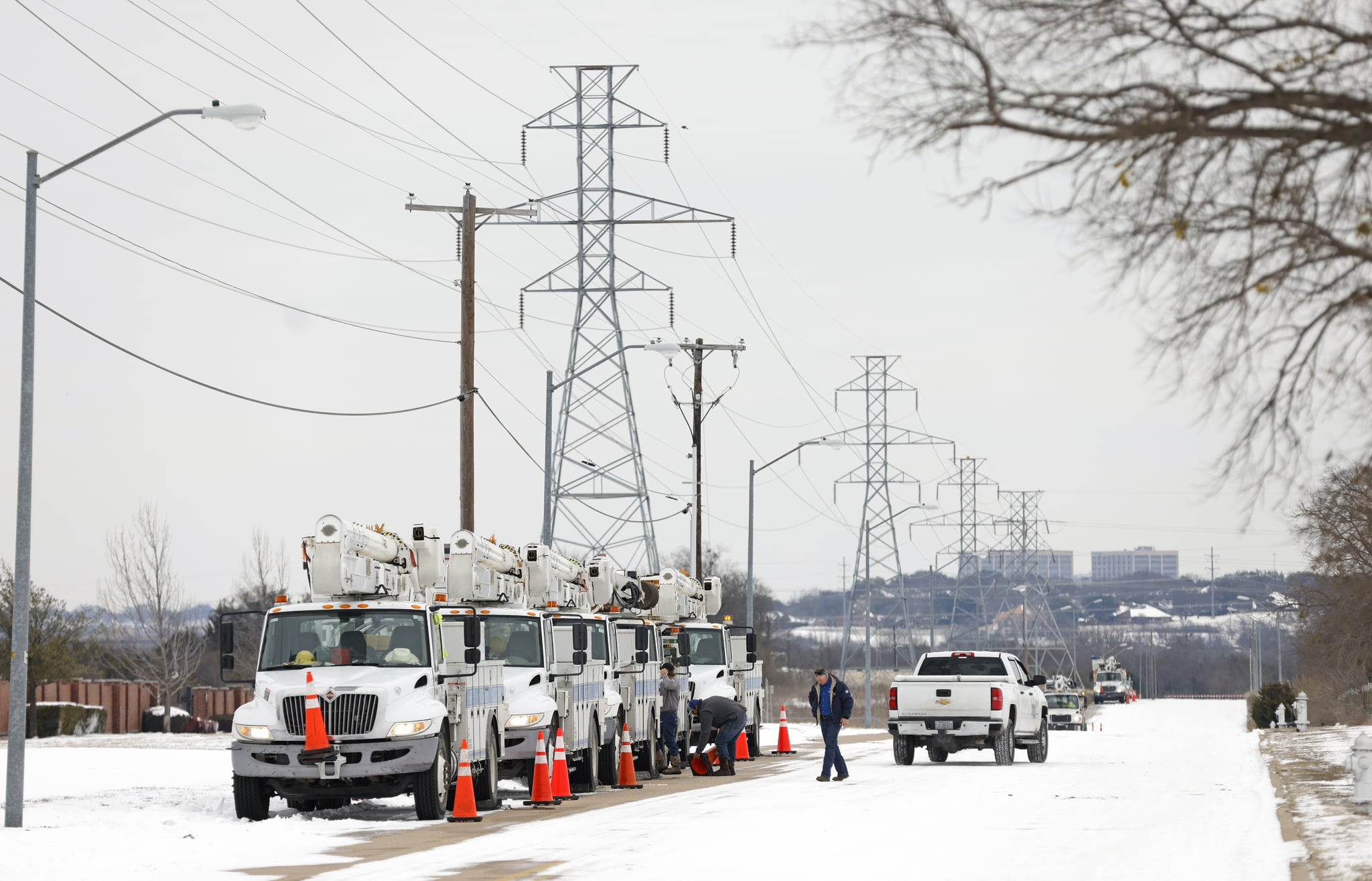 FORT WORTH, TX - FEBRUARY 16: Pike Electric service trucks line up after a snow storm on February 16, 2021 in Fort Worth, Texas. Winter storm Uri has brought historic cold weather and power outages to Texas as storms have swept across 26 states with a mix of freezing temperatures and precipitation. (Photo by Ron Jenkins/Getty Images)
