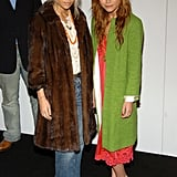 Twinning combo: During Spring 2005 New York Fashion Week, the Olsens proved the power of statement outerwear, bundling up in two noteworthy coats.  Mary-Kate played the colour card, layering an apple-green coat over her punchy slip dress.  Ashley warmed up in a luxe, chocolate-coloured fur and light-wash denim.