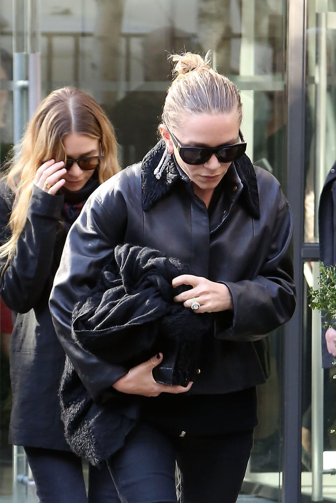 They looked chic in the sunglasses style and all-black outfits in Paris in 2014.