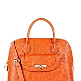 In a bright tangerine shade, this French grain textured leather satchel is a sunny Summer must.  DKNY Beekman French Grain Mini D Round Satchel ($335)