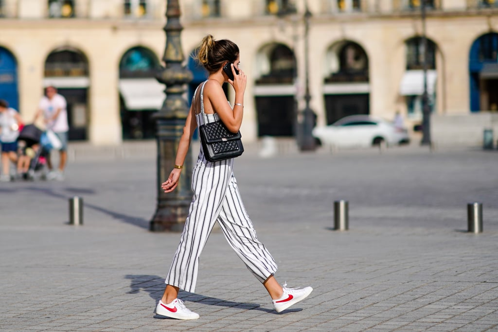 Finishing an easy jumpsuit with sneakers is always a reliable — and cute! — weekend look.