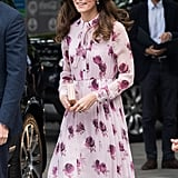 . . . and three months later at a World Mental Health Day event, Kate wore a pink flower-print 1970s-style dress by Kate Spade.