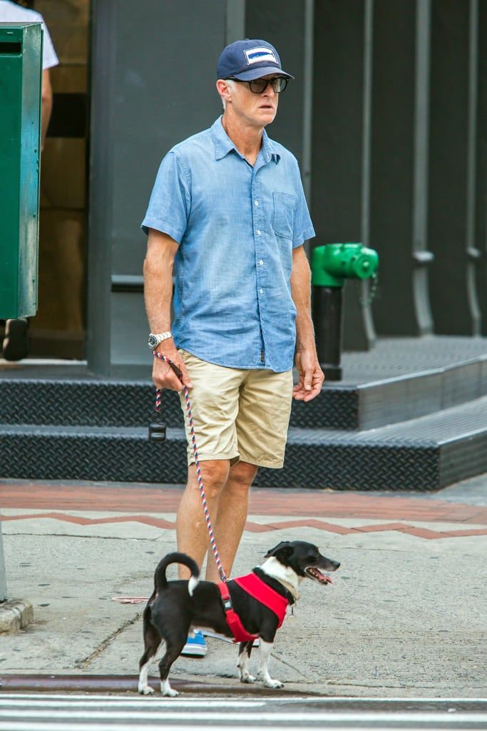 John Slattery walked his canine companion around NYC in July 2015.