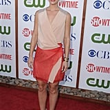 Claire Danes in a red and beige wrap dress by Reed Krakoff.