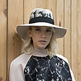 Elena Perminova kept coordinated with a wide-brim hat to complement her Louis Vuitton top.