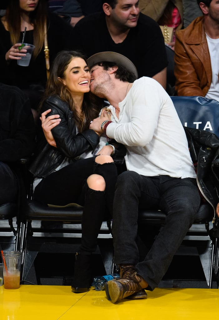 """Ian Somerhalder showed serious PDA with girlfriend Nikki Reed when the couple sat courtside at a Lakers game in LA on Sunday. The pair were fresh off a Christmas trip to Sun Valley, ID, where they got in the Winter spirit by hitting the slopes alongside Nikki's brother. The actor shared one cute moment on Instagram on Friday, writing, """"No filter for this sunny Sun Valley of awesomeness with my loves, the incredible Nikki Reed and my brother Nathan August Reed."""" Clearly Ian is getting along with Nikki's family as he is already calling Nathan his brother! The couple's relationship has been moving steadily along ever since they went public with their romance back in July. Since then, the pair have shared sweet selfies and public messages of love on their Instagram accounts."""