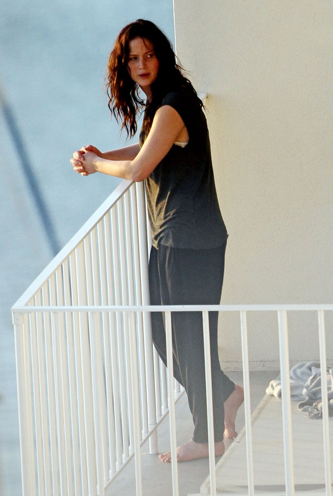 Jennifer Lawrence talked with a friend on her balcony in Hawaii on Wednesday.
