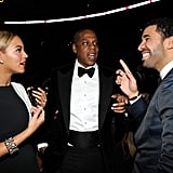 Beyoncé and Jay-Z chatted with a very smiley Drake backstage at the Grammys.