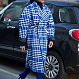 Lean into a full-blown plaid look with a bold coat and checked pumps.