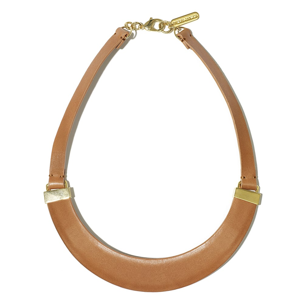 If you're a minimalist by nature, this nude-toned necklace will fit right into the accessory rotation. Paired with a silky blouse and pencil skirt, this leather iteration should give your office outfit a slick edge. Vince Camuto Leather Collar Tan Necklace ($88)