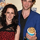 Robert Pattinson and Kristen Stewart pressed against each other in the MTV VMAs press room in May 2009.
