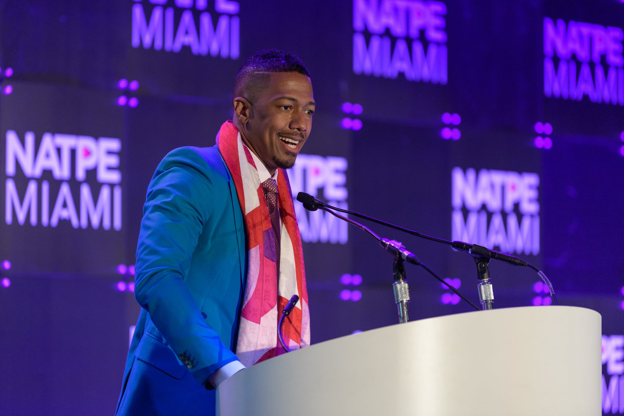 MIAMI BEACH, FL - JANUARY 22:  Nick Cannon speaks on stage during NATPE Miami 2020 - Iris Awards at Fontainebleau Hotel on January 22, 2020 in Miami Beach, Florida.  (Photo by Jason Koerner/Getty Images)