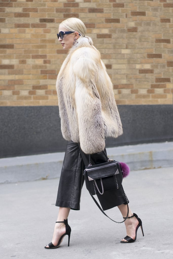 With a Furry Coat and Heeled Sandals