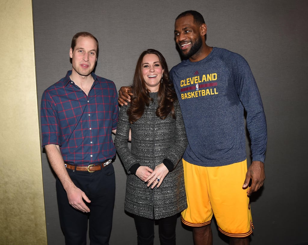"""On Monday night, the Duke and Duchess of Cambridge watched the Cleveland Cavaliers square off against the Brooklyn Nets in NYC, but everyone was more focused on their meeting with Beyoncé and Jay Z and, later, LeBron James's """"protocol breach"""" when he met the couple after the game to take pictures and hand out gifts. The offending action? LeBron was photographed putting his arm around Kate's shoulder while the group leaned together to pose for photographs. While the action may have seemed completely innocent to most, royal etiquette experts know that people are strongly discouraged from touching any member of the royal family aside from a handshake (and, even then, that's only after they've offered their hand first). However, there is no strict rule on how to behave around the royal family; it's merely a suggestion. Naturally, etiquette sticklers were a little upset by LeBron's shoulder touch, with author William Hanson declaring that it was an example of """"an American being too touchy feely with British royalty,"""" although he admitted that Kate probably didn't care. He added, """"You'd have thought [that Americans would] have learned by now."""" It's true that Americans have raised eyebrows in the past for touching members of the royal family, with the most notable being First Lady Michelle Obama touching Queen Elizabeth II's back during a meeting in 2009. But did LeBron actually do anything wrong? No. While it's always good to respect other people's personal boundaries (be they royal or not), being squished together for a photo-op pretty much calls for a hand-around-the-shoulder motion. LeBron surely wanted to show the royals respect, but it isn't like he was at a diplomatic event at Buckingham Palace — the royal couple were visiting with him after a basketball game and the setting was incredibly casual. He probably would have done the same if the Obamas replaced the Cambridges that night.  Besides, a royal communications officer has gone on the record that LeBron behaved """