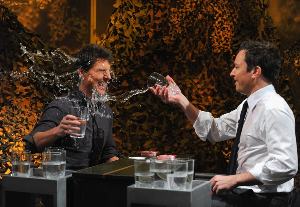 Tom Cruise laughed as Jimmy Fallon tossed a glass of water in his face.