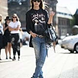 Don't just throw on your jeans — a vintage tee, covetable bag, and ankle-strap heels make them an outfit. Source: Le 21ème | Adam Katz Sinding
