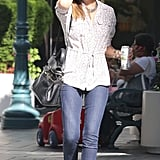 Jessica Alba perfected effortless street style in an easy button-down and denim.