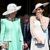 Then, Camilla and Meghan couldn't stop laughing as a bee attacked Harry during his speech.