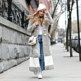 With a Long Fuzzy Jacket, a White T-Shirt, Socks, and Sneakers