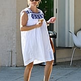 Reese Witherspoon wore dark sunglasses.