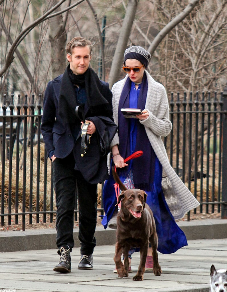 Anne Hathaway read while she and Adam Shulman walked the dog.