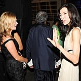 Kate Moss chatted with fellow partygoers at the artsy party in Hong Kong.