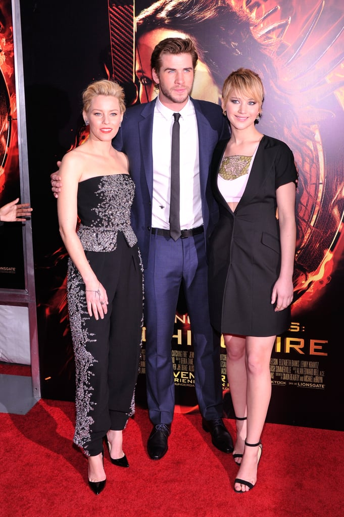 Just like Katniss and Peeta, the cast of Catching Fire has been embarking on what can only be described as a victory tour for the past couple weeks. Tonight's premiere brought the gang to New York, and as we suspected, everyone looked dazzling as ever. Jennifer Lawrence was ablaze in another Dior knockout, a little black dress, and had glowing, star-studded support from Liam Hemsworth, Jena Malone, and Elizabeth Banks. It seems Josh Hutcherson was not present, but we've got plenty of reasons to love him in spite of his absence. The cast has been flying all over the world to promote the second film in The Hunger Games trilogy; they stormed through Europe's biggest cities, including Rome, Paris, and Berlin, and even made a pit stop in LA. And every step of the way, all of the stars have sported glowing smiles, participated in plenty of adorable moments, and wowed us with more fashionable ensembles then we could handle.