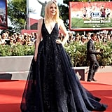 Dakota Fanning glittered in a dress from Elie Saab's Fall 2013 Couture collection and rings by Cathy Waterman and Rona Pfeiffer at the premiere of Night Moves.
